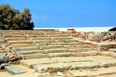 Minoan steps at Malia ruins, Crete. Wide steps to one of the buildings within the Minoan Malia ruins archaeological site, Malia, Crete, Greece, Europe Royalty Free Stock Photo