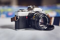 Minolta Grey and Black Mcla on Grey Table Royalty Free Stock Images