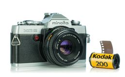 A Minolta XG2 35mm analog film camera. NIEDERSACHSEN, GERMANY April 9, 2019: A Minolta XG2 35mm analog film camera on a white background with Kodak film stock image