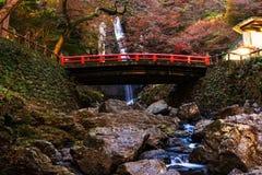 Minoo waterfall autumn, Osaka. Minoo or Minoh waterfall with  Red bridge and autumn leaves, Osaka, Japan Royalty Free Stock Photography