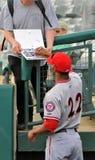Minor league baseball - autographs. TRENTON, NJ - APRIL 21: Harrisburg Senators outfielder Destin Hood signs autographs for a fan prior to the Eastern League Royalty Free Stock Images