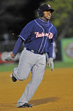 Minor League Baseball baserunner - heading home Stock Photos