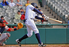 Minor league baseball - batter connects Stock Image