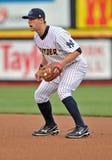 Minor League baseball - batter runs to first Stock Photo