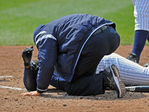 Minor League baseball injury at the plate Royalty Free Stock Image