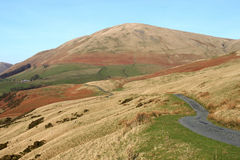 Minor road on the West side of Howgill Fells. Royalty Free Stock Photo