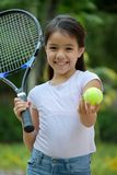 Minority Child Athlete And Happiness With Tennis Racket. An attractive and asian person royalty free stock photo
