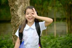 Minority Child Girl Student Searching Wearing School Uniform With Notebooks. A young pretty asian girl child royalty free stock photo