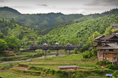 Minority Chinese village. Minority village of Chengyang with houses and the famous old bridge Stock Images