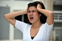 Minority Female Memory Problems. A pretty young asian female stock photo