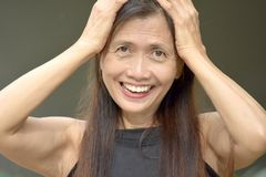 Minority Female Senior Memory Problems. An attractive and asian person royalty free stock photos