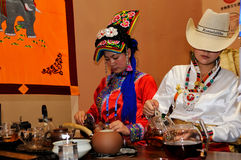 Minority girls serving tea,2013 WCIF Royalty Free Stock Photography