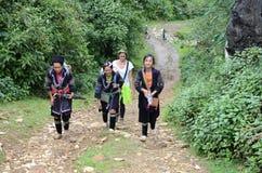 Minority Vietnamese women walking with a tourists Stock Photo