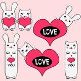 Minous mignons et lapins retenant des coeurs Images stock