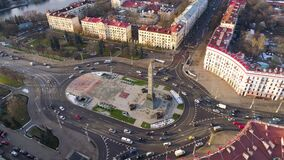Minsk aerial drone shot autumn of the city center view from above Victory square. Yellow trees private houses on background stock video