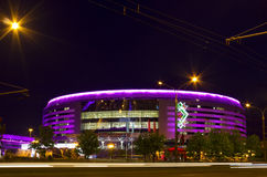 Minsk Arena, Belarus. MINSK, BELARUS - MAY 9, 2014: Night view of illuminated Minsk Arena building during the Ice Hockey World Championship 2014. Minsk Arena is Royalty Free Stock Photos