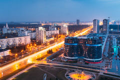 Minsk, Belarus. Aerial Cityscape In Bright Blue Hour Evening And Yellow Illumination Spring Twilight. Stock Photography