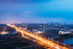 Minsk, Belarus. Aerial View Cityscape In Bright Blue Hour Evening And Yellow Illumination Spring Twilight. Stock Photo