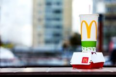 Minsk, Belarus, April 24, 2018: Big Mac and soft drink cup on table in McDonald`s restaurant terrace Stock Image