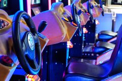Minsk Belarus - April 20 2019 : Car driving machines at arcade games in the entertainment zone in shopping center on stock photos