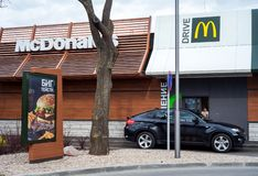 Minsk, Belarus, April 20, 2018: Customer receiving order from McDonald`s drive thru service royalty free stock image