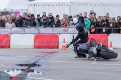 MINSK, BELARUS - APRIL 24, 2016 HOG. Harley Owners Group opening driving season show. Man falling down after stunt riding with bla. MINSK, BELARUS - APRIL 24 Stock Image
