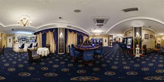 MINSK, BELARUS - APRIL 18, 2016: Panorama interior elite casino near the bar with croupier. Full spherical 360 by 180 degrees royalty free stock image