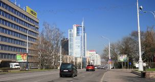 Minsk, Belarus. Traffic At Pobediteley Avenue. In Sunny Spring Day. Minsk, Belarus - April 4, 2017: Traffic At Pobediteley Avenue. In Sunny Spring Day stock footage