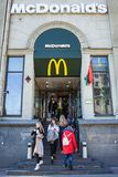 Minsk, Belarus, April 4, 2018: Visitors enter and exit from the McDonald`s restaurant. Stock Photo