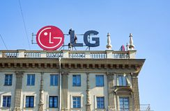 Minsk, Belarus, April 4, 2018: Workers mount LG advertising on the roof of the building Stock Photo