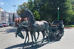 MINSK, BELARUS - AUGUST 01, 2013: City bronze sculpture `The Carriage for the Governor`. Royalty Free Stock Image