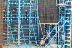 Minsk, Belarus, August 27, 2013: Construction of Turkish workers. Renaissance Hotel in the center of Minsk Stock Image