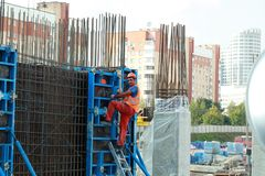 Minsk, Belarus, August 27, 2013: Construction of Turkish workers. Renaissance Hotel in the center of Minsk many workers on building site Stock Photo