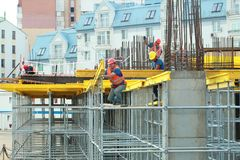 Minsk, Belarus, August 27, 2013: Construction of Turkish workers. Renaissance Hotel in the center of Minsk Stock Images