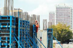 Minsk, Belarus, August 27, 2013: Construction of Turkish workers. Renaissance Hotel in the center of Minsk many workers on building site Royalty Free Stock Photography
