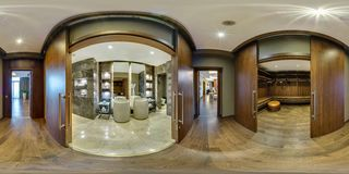 MINSK, BELARUS - AUGUST 2017: full seamless panorama 360 angle view in elite vip bathroom and wardrobe in loft hotel. Spherical stock images