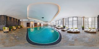 MINSK, BELARUS - AUGUST, 2017: Full seamless panorama 360 degrees angle view in interior of modern swimming pool in elite hotel in royalty free stock photo