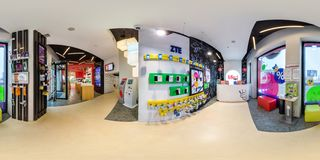 MINSK, BELARUS - AUGUST, 2017: Full spherical 360 angle degrees seamless panorama in interior modern store salon of mobile stock photography