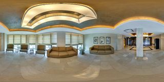 MINSK, BELARUS - AUGUST, 2017: Full spherical 360 degrees seamless panorama in panorama in guestroom hall with sofa of modern royalty free stock image