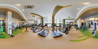 MINSK, BELARUS - AUGUST, 2017: Full spherical seamless 360 degree angle view panorama in big stylish fitness club with sports stock photo