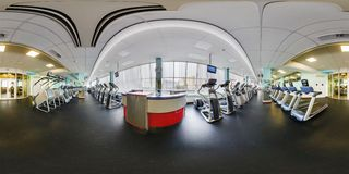 MINSK, BELARUS - AUGUST, 2017: Full spherical seamless 360 degree angle view panorama in big stylish fitness club with sports royalty free stock photography