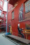 Graffiti on wall of house pianist, saxophonist, cellist, Red Yard, Minsk, Belarus. MINSK, BELARUS - AUGUST 17, 2018: Graffiti on wall of house pianist stock images