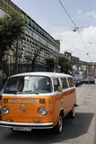 Minsk, Belarus, August 14 2018 - white and Orange Volkswagen Type 2 VW T2 parked on the street, known as the Transporter. Minsk, Belarus, August 14 2018 - Orange stock photos