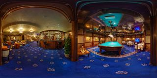 MINSK, BELARUS - AUGUST 15, 2012: Panorama in interior in stylish hall in modern casino with Croupiers. Full 360 degree seamless stock photography