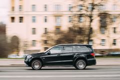 Minsk, Belarus. Big Black Color Mercedes-benz GLS Class In Fast. Minsk, Belarus - April 7, 2017: Big Black Color Mercedes-benz GLS Class In Fast Motion On Street Stock Photos