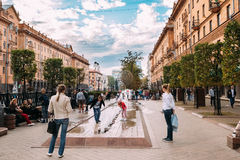 Minsk, Belarus. Children Play Near A Fountain Under The Supervision. Minsk, Belarus - September 3, 2016: Children Play Near A Fountain Under The Supervision Of Royalty Free Stock Photos