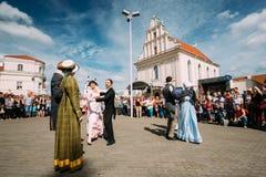Minsk, Belarus. Couple of people dressed in clothes of the 19th. Minsk, Belarus - September 3, 2016: Couple of young people dressed in clothes of the 19th Stock Photography