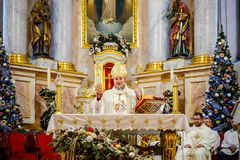CHRISTMAS CATHOLIC SPIRITUAL SERVICES HELD IN THE CHURCH. MINSK, BELARUS - DECEMBER 25, 2017: CHRISTMAS CATHOLIC SPIRITUAL SERVICES HELD IN THE CHURCH royalty free stock photography