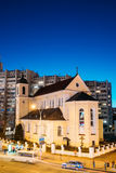 Minsk, Belarus. Evening Night View Of Cathedral of the Holy Apostles Sts Peter and Paul On Illuminated Nemiga Street. Minsk, Belarus - April 3, 2017: Evening Royalty Free Stock Images