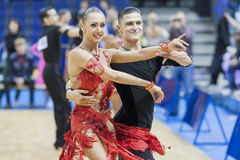 MINSK-BELARUS, FEBRUARY, 9: Andrey Kitcun-Nataliya Korsak Perform Adult Latin-American Program on Ogni Stolicy (Lights of the Cap. Ital) 2014 WDSF Championship stock photography
